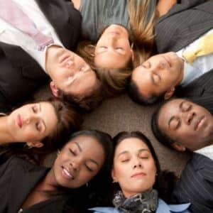 group of people laying in a circle feeling good